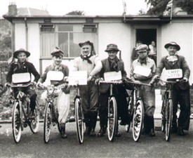 Photo:Fancy dress bicycle competition in front of prefabs at Preston Park, Linlithgow, 1950s.