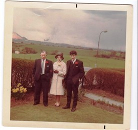 Photo:Jackie and Grace Davidson and Bobby early 70s. The viaduct can be seen and the Stoneyburn bing. The field behind is where the school is now.