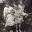 Photo:Mrs Stein with her children in the garden at Beechwood Cottage, early 1930s.
