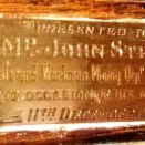 Photo:Inscription on the clock presented to John Stein in 1919.