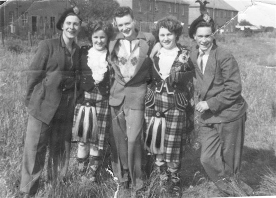 Photo:Matt, Alex and James Morris, with Highland dancers at the 1953 gala day.