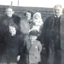 Photo:Meg Stein (nee Haig) (centre), with her parents John and Margaret Haig, and her three children Margaret, Jim and Jean, the baby, c. 1927.