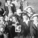 Photo:John Kelly (middle row, right), with friends on a pub trip, 1950s.