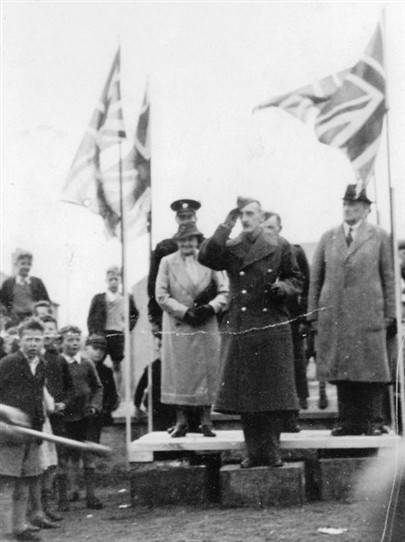 Photo:Ma Moore takes the salute at a wartime or victory parade.