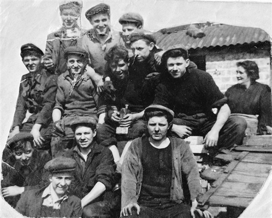 Photo:Young miners at Loganlea Colliery.  Far right, Sarah Thompson. Middle row (L-R): unknown, John Kelly, unknown, Tommy Curran.