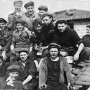 Photo:Loganlea Colliery miners.  In the background, Sarah Thomson, who worked on the tables, sorting out stones from the coal. Nearest to her, in dark shirt, Tommy Curran.
