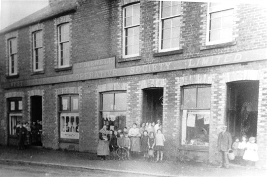 Photo:Addiewell branch of West Calder Co-operative, with the Institue Hall above.