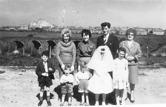 Photo:The McInally family of Stoneyburn after their daughter's First Communion.  In the background you can see the west of the two railway viaducts.  Also visible in the background is Foulshiels Bing, and part of Cuthill Crescent in Stoneyburn.  1960.