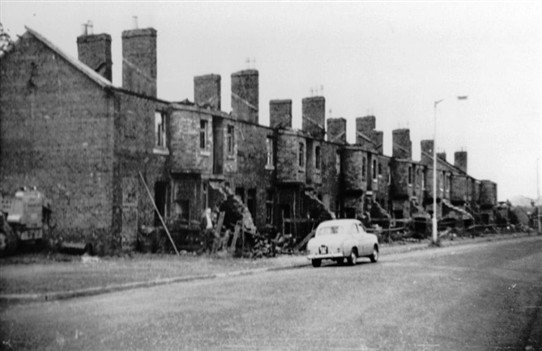 Photo:Livingstone Street in the process of demolition, 1960s.  Note Willie Cramb standing at the door of his house.