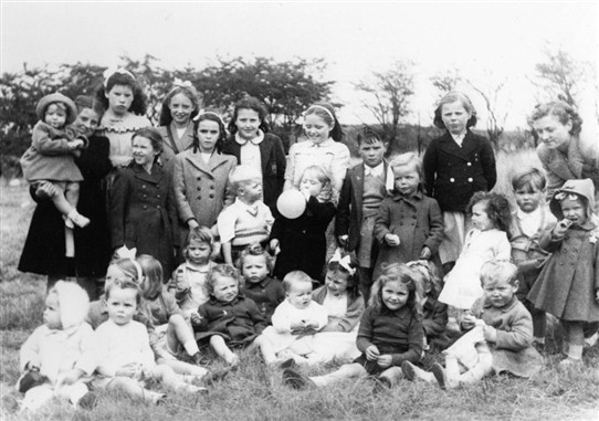 Photo:Loganlea Gala Day, 1946 or 1947.  Who are they?  And where are they now?  If you know, tell us.   Baby front right is David Pennykid.  Girl back row on the left, wearing a frilly top, Betty Oliver.