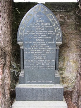 Photo:The Sneddons' gravestone in West Calder Cemetery.